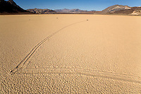 ONE OF THE MYSTERIOUS SLIDING ROCKS AT RACETRACK PLAYA TAKES AN ABRUPT RIGHT TURN AT DEATH VALLEY NATIONAL PARK, CALIFORNIA