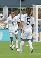 Davy Arnaud (22) passes the ball to Kyle Beckerman (5). USA defeated Grenada 4-0 during the First Round of the 2009 CONCACAF Gold Cup at Qwest Field in Seattle, Washington on July 4, 2009.