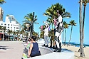 """FORT LAUDERDALE, FLORIDA - JANUARY 28:  PETA Body-Painted animal's supporters are painted as a cow, rabbit, alligator, parrot, and a deer during a Rally Against Injustice with signs proclaiming, """"Reject White Supremacy,"""" """"Reject Heterosexual Supremacy,"""" """"Reject Human Supremacy,"""" and """"Reject Male Supremacy."""" at E. Las Olas Boulevard and S. Fort Lauderdale intersection on January 28, 2021 in Fort Lauderdale, Florida. The demonstration is part of PETA's ongoing call to action against specimens, the damaging belief that other animals are ours to use and abuse.  ( Photo by Johnny Louis / jlnphotography.com )"""