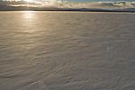 Frozen over Tule Lake in winter at sunset, Tule Lake National Wildlife Refuge, California