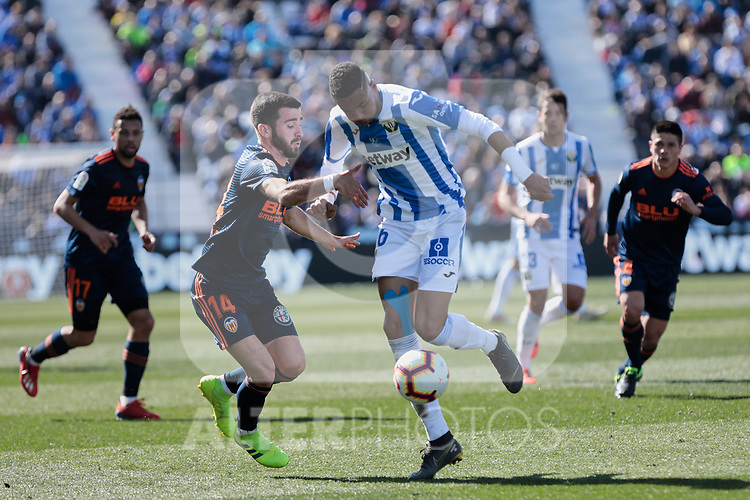 CD Leganes's Youssef En-Nesyri and Valencia CF' Jose Gaya during La Liga match, Round 25 between CD Leganes and Valencia CF at Butarque Stadium in Leganes, Spain. February 24, 2019. (ALTERPHOTOS/A. Perez Meca)