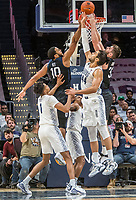 WASHINGTON, DC - JANUARY 28: Bryce Nze #10 and Bryce Golden #33 of Butler go up for the ball against Omer Yurtseven #44 of Georgetown during a game between Butler and Georgetown at Capital One Arena on January 28, 2020 in Washington, DC.