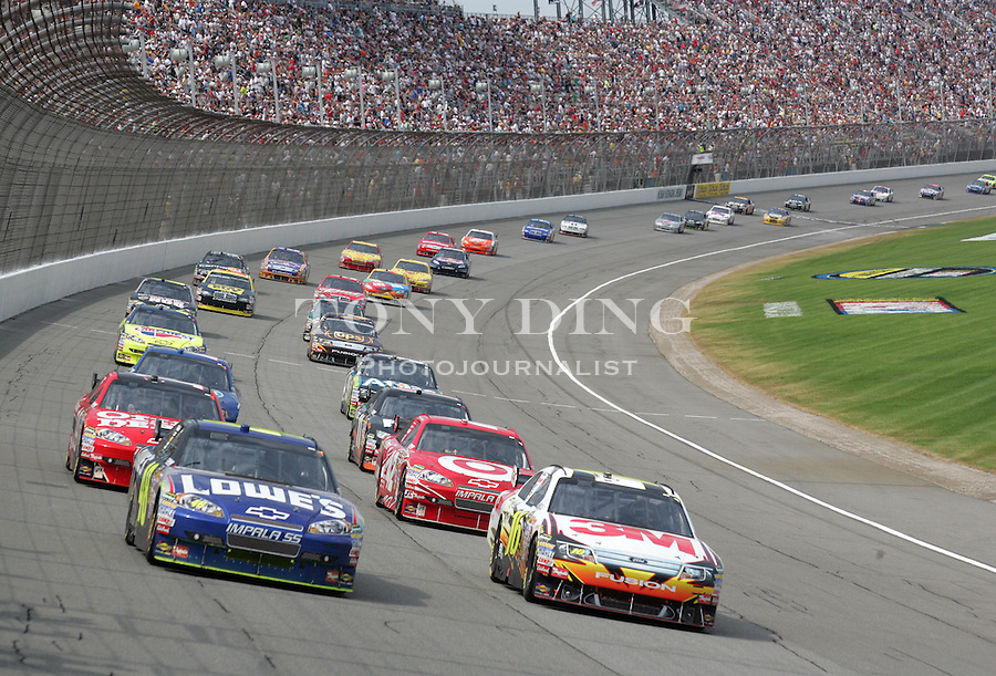 14 June 2009: Jimmie Johnson, driver of the #48 Lowe's Chevrolet, and Greg Biffle, driver of the #16 3M Ford, lead the two column field through turn one during a caution during the running of the NASCAR Sprint Cup Series LifeLock 400 at Michigan International Speedway in Brooklyn, MI.