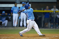 Jesus Atencio (31) of the Burlington Royals follows through on his swing against the Johnson City Cardinals at Burlington Athletic Stadium on September 3, 2019 in Burlington, North Carolina. The Cardinals defeated the Royals 7-2 to even Appalachian League Championship series at one game a piece. (Brian Westerholt/Four Seam Images)