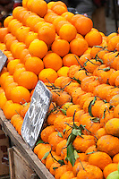 A market stall street market merchant selling oranges in big piles some with leaves and some without Montevideo, Uruguay, South America