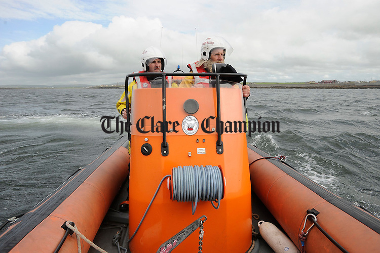 Tom Doherty, right, Deputy Area Officer with the Doolin Unit of the Irish Coastguard and crewman Martoni Vaughan, co-ordinating the safety of all competitors at the Leon Currach Regatta at Seafield, Quilty. Photograph by John Kelly.