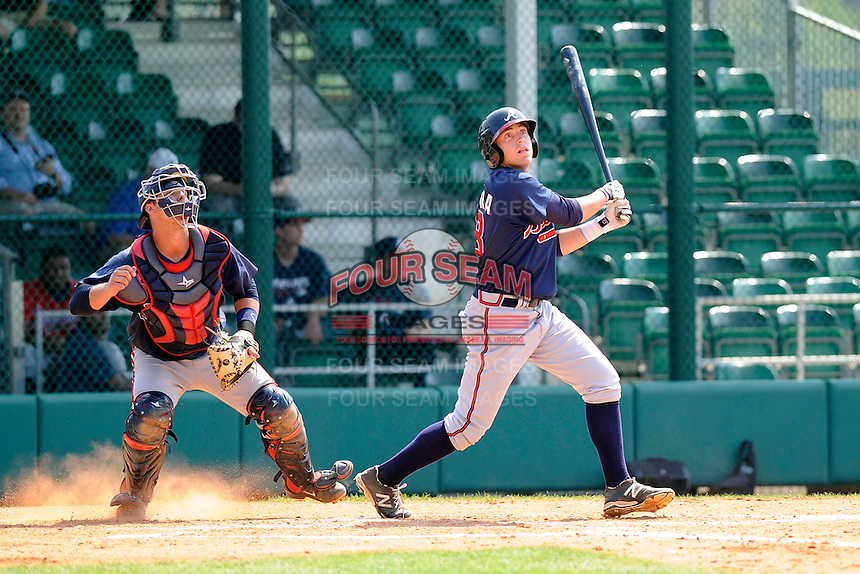 Infielder Luke Dykstra (10) of the Atlanta Braves farm system in a Minor League Spring Training intrasquad game on Wednesday, March 18, 2015, at the ESPN Wide World of Sports Complex in Lake Buena Vista, Florida. The catcher is Tanner Murphy. (Tom Priddy/Four Seam Images)
