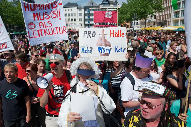 """Protest gegen Rechtspopulisten in Koeln.<br /> Mehr als 1000 Menschen protestierten am Samstag den 7. Mai 2011 in Kolen gegen einen sog. """"Marsch fuer die Feiheit"""" zu dem die Rechtspopulisten von Pro Koeln und Pro-NRW sowie die rechtsextremen Republikaner aufgerufen hatten. Mit der rechtsradikalen Demonstration sollte gegen eine angebliche Islamisierung Europas protestiert werden. Die Rechten wurde von lautstarken Protesten begleitet und mussten nach einer Zwischenkundgebung wegen verschiedener Sitzblockaden durch koelner Buerger und diverse antifaschistische Gruppen ihre Demonstration abbrechen.<br /> 7.5.2011, Koeln<br /> Foto: Christian-Ditsch.de<br /> [Inhaltsveraendernde Manipulation des Fotos nur nach ausdruecklicher Genehmigung des Fotografen. Vereinbarungen ueber Abtretung von Persoenlichkeitsrechten/Model Release der abgebildeten Person/Personen liegen nicht vor. NO MODEL RELEASE! Don't publish without copyright Christian-Ditsch.de, Veroeffentlichung nur mit Fotografennennung, sowie gegen Honorar, MwSt. und Beleg. Konto:, I N G - D i B a, IBAN DE58500105175400192269, BIC INGDDEFFXXX, Kontakt: post@christian-ditsch.de]"""
