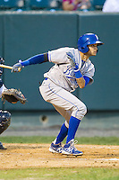 Ariel Estades (21) of the Burlington Royals follows through on his swing against the Pulaski Mariners at Calfee Park on June 20, 2014 in Pulaski, Virginia.  The Mariners defeated the Royals 6-4. (Brian Westerholt/Four Seam Images)