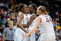 NORFOLK, VA--Sisters Nneka and Chiney Ogwumike celebrate with  teammate Joslyn Tinkle a three point play during competition against West Virginia University at the Ted Constant Convocation Center at Old Dominion University for the second round of the 2012 NCAA Championships. The Cardinal advanced to the West Regionals in Fresno with a score of 72-55.