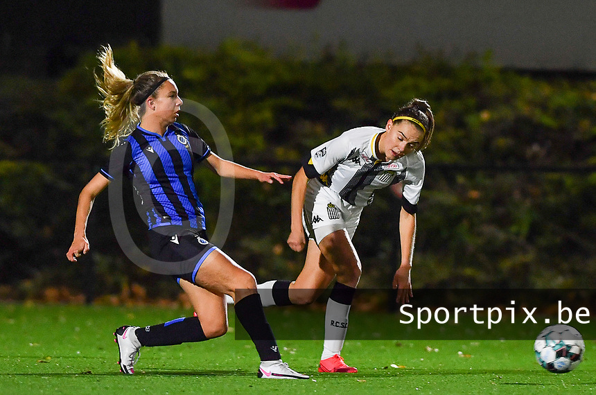 Brugge's Talitha De Groote pictured with forward Renate Ly Mehevets of Sporting Charleroi during a female soccer game between Sporting Charleroi and Club Brugge YLA on the fourth matchday of the 2020 - 2021 season of Belgian Scooore Womens Super League , friday 9 nd of October 2020  in Marcinelle , Belgium . PHOTO SPORTPIX.BE | SPP | DAVID CATRY