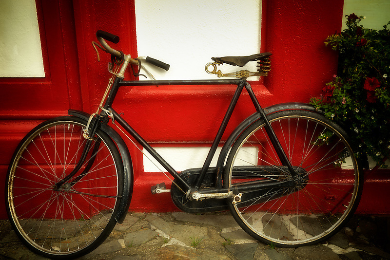 Old bicycle at store front. Knightstown,Valentia Island,Republic of Ireland