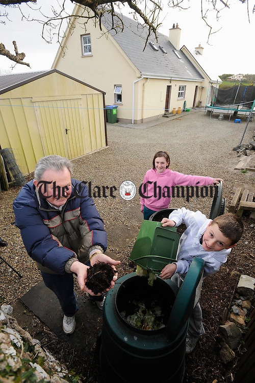 The O Connors of Bushy Park, Ennis; Bill, Jessica and William, who compost 100 % of their vegetable and fruit waste. Photograph by John Kelly.