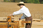 Heritage Days Festival. Union County. Making split rail fence posts. Drilling fence rail hole.
