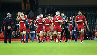 Pictured: Wales players led by (front L-R) team captain Sam Warburton, Samson Lee, Gethin Jenkins and Taulupe Faletau, thank supporters after the final whistle Saturday 29 November 2014<br />