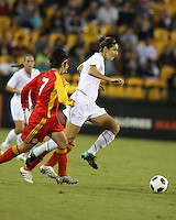 Yael Averbuch #4 of the USA WNT moves away from Lisha Sun #7 of the PRC WNT during an international friendly match at KSU Soccer Stadium, on October 2 2010 in Kennesaw, Georgia. USA won 2-1.