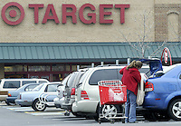 A customer loads her trunk in the parking lot of a Target store Tuesday, Nov. 14, 2006 in Columbus, Ohio.<br />