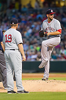 Pawtucket Red Sox manager Kevin Boles (19) looks on as starting pitcher Matt Barnes (34) throws a pitch at BB&T Ballpark on August 9, 2014 in Charlotte, North Carolina.  The Red Sox defeated the Knights  5-2.  (Brian Westerholt/Four Seam Images)