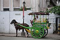 Philippines, Manila, 5 march, 2008..Traditional horse taxi in Real Street in Intramuros the oldest district of the city of Manila...Traditionele paarden taxi in Intramuros, het oudste district van Manila, de hoofdstad van de Filippijnen...Photo Kees Metselaar
