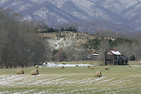 Mountain scenes and farm land.