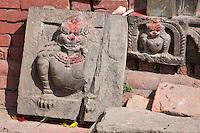 Kathmandu, Nepal.  Snow Leopards Carved in Stone inside a Neglected Neighborhood Hindu temple.