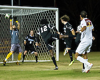 The Winthrop University Eagles beat the UNC Asheville Bulldogs 4-0 to clinch a spot in the Big South Championship tournament.  Winthrop's Achille Obougou (7) scores over the outstretched arms of Asheville goalkeeper Dan Jackson (1)