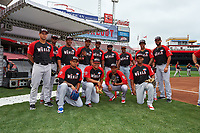 World Team members from the Dominican Republic - (Standing L-R) Gary Sanchez, Raimel Tapia, Keury Mella, Jarlin Garcia, Socrates Brito, Rodney Linares, Manuel Margot, Raul Adalberto Mondesi, Nomar Mazara; (Kneeling L-R) Jairo Labourt, Frank Montas, Alex Reyes, Rafael Devers - pose for a photo before the MLB All-Star Futures Game on July 12, 2015 at Great American Ball Park in Cincinnati, Ohio.  (Mike Janes/Four Seam Images)