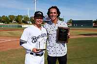 Peoria Javelinas second baseman Keston Hiura (23), of the Milwaukee Brewers organization, and Surprise Saguaros shortstop Cole Tucker (right), of the Pittsburgh Pirates organization, pose with their 2018 Arizona Fall League Awards before the Arizona Fall League Championship Game against the Peoria Javelinas at Scottsdale Stadium on November 17, 2018 in Scottsdale, Arizona. Hiura won the 2018 Arizona Fall League Most Valuable Player Award while Tucker was awarded the Dernell Stenson Sportsmanship Award. (Zachary Lucy/Four Seam Images)