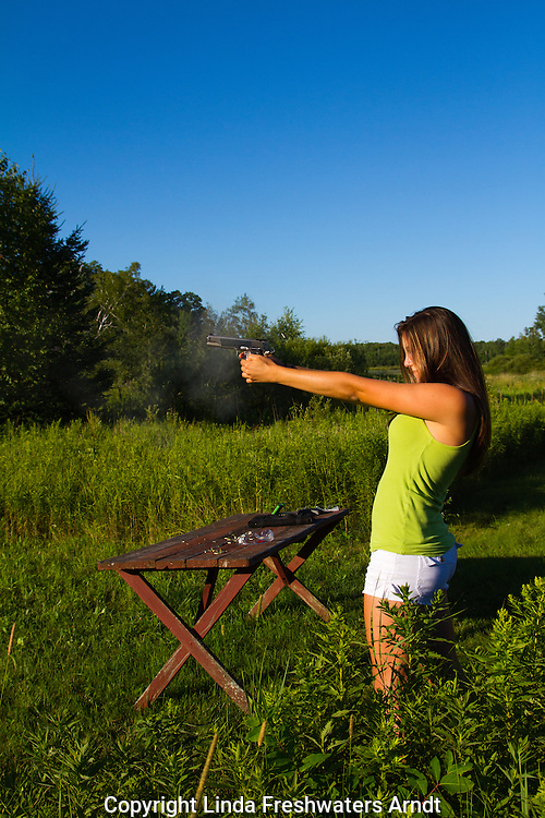 Young women shooting a Springfield 1911 .45 ACP