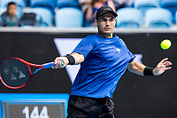 8th February 2021, Melbourne, Victoria, Australia;  Marcos Giron of the United States of America returns the ball during round 1 of the 2021 Australian Open on February 8 2020