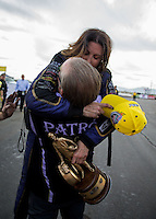 Feb 23, 2014; Chandler, AZ, USA; NHRA funny car driver Alexis DeJoria celebrates with husband Jesse James after winning the Carquest Auto Parts Nationals at Wild Horse Motorsports Park. Mandatory Credit: Mark J. Rebilas-USA TODAY Sports
