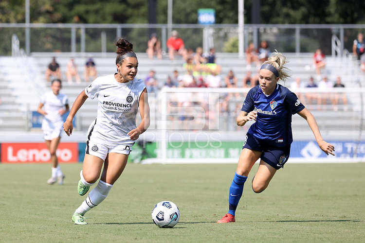 CARY, NC - SEPTEMBER 12: Sophia Smith #9 of the Portland Thorns FC is chased by Denise O'Sullivan #8 of the North Carolina Courage during a game between Portland Thorns FC and North Carolina Courage at Sahlen's Stadium at WakeMed Soccer Park on September 12, 2021 in Cary, North Carolina.