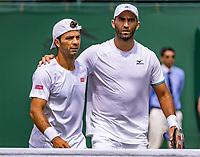 London, England, 5 July, 2019, Tennis,  Wimbledon, Men's doubles: Jean-Julien Rojer (NED) and Horia Tecau  (ROU) (R) celebrate<br /> Photo: Henk Koster/tennisimages.com