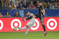 CARSON, CA - SEPTEMBER 15: Sebastian Lletget #17 of the Los Angeles Galaxy passes a ball past Luis Martins #36 of Sporting Kansas City during a game between Sporting Kansas City and Los Angeles Galaxy at Dignity Health Sports Complex on September 15, 2019 in Carson, California.