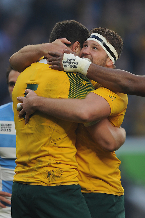 Rob Simmons of Australia (left) is congratulated by teammate James Slipper of Australia after scoring an early try during the Semi Final of the Rugby World Cup 2015 between Argentina and Australia - 25/10/2015 - Twickenham Stadium, London<br /> Mandatory Credit: Rob Munro/Stewart Communications