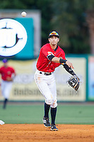 Charleston RiverDogs shortstop Tyler Wade (7) makes a throw to first base to complete a double play against the Greenville Drive at Joseph P. Riley, Jr. Park on May 26, 2014 in Charleston, South Carolina.  The Drive defeated the RiverDogs 11-3.  (Brian Westerholt/Four Seam Images)