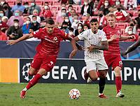 14th September 2021; Sevilla, Spain: UEFA Champions League football, Sevilla FC versus RB Salzburg; Erik Lamela of Sevilla  and Nicolas Seiwald of Salzburg  chase a through ball