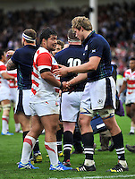 Kensuke Hatakeyama of Japan shakes hands with Jonny Gray of Scotland after the match. Rugby World Cup Pool B match between Scotland and Japan on September 23, 2015 at Kingsholm Stadium in Gloucester, England. Photo by: Patrick Khachfe / Stewart Communications