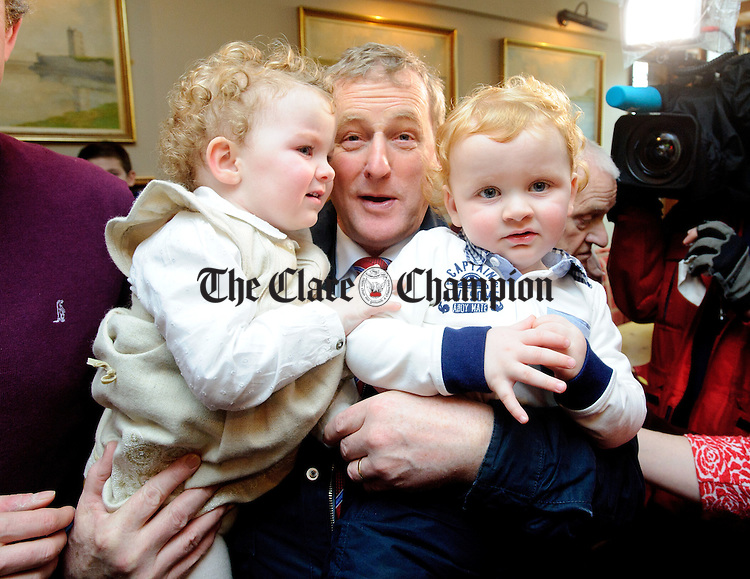 Enda Kenny, Taoiseach with twins James and Eve Carmody during his visit to Loop Head to launch the Fine Gael tourism initiative. Photograph by John Kelly.