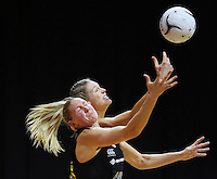 New Zealand's Casey Williams and Australia's Caitlin Bassett compete for the ball in the New World Quad series netball match, Claudelands Arena, Hamilton, New Zealand, Thursday, November 01, 2012. Credit:NINZ / Dianne Manson.