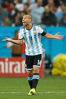 Javier Mascherano of Argentina shouts to team mates