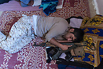 13/08/14  Iraq -- Daquq, Iraq -- A peshmerga sleeps with his gun at the base in Daquq.