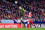 Jeremy Mathieu of Sporting CP (C) fights for the ball with Kevin Gameiro of Atletico de Madrid (R) during the UEFA Europa League quarter final leg one match between Atletico Madrid and Sporting CP at Wanda Metropolitano on April 5, 2018 in Madrid, Spain. Photo by Diego Souto / Power Sport Images