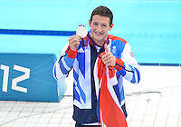 August 01, 2012..Michael Jamieson of Great Britain holding on to his 200m Breaststroke Silver Medal as he walks around the pool at the conclusion of award ceremony at the  Aquatics Center on day five of 2012 Olympic Games in London, United Kingdom.