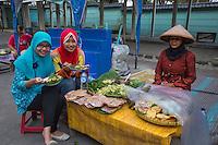 Yogyakarta, Java, Indonesia.  Indonesian Girls Having Lunch near the Exit from the Prambanan Temple Compound.