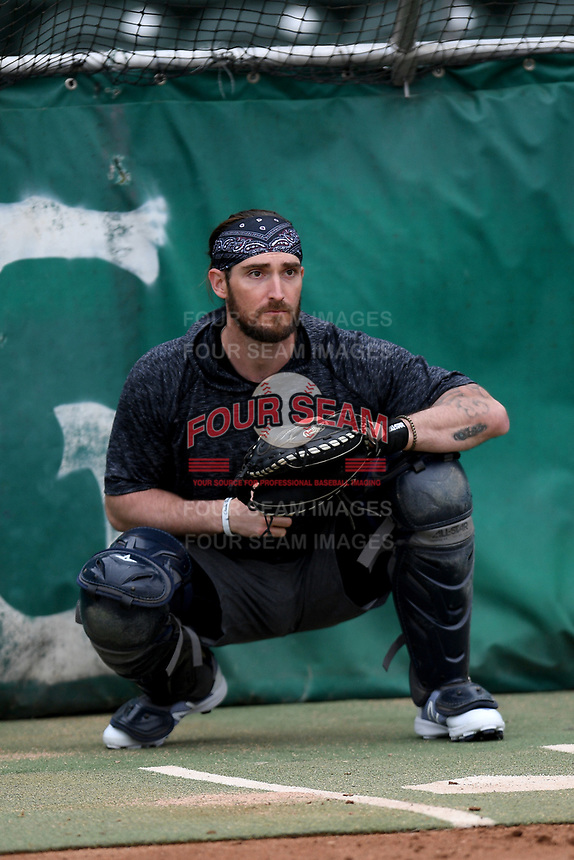 Catcher John Nester, former Clemson Tiger from Riverside H.S., works out with other pros from around the region on Tuesday, June 16, 2020, at Fluor Field at the West End in Greenville, South Carolina. Team workouts have been shut down during the coronavirus pandemic, so this group began working out in game situation simulations a couple of days a week. Drafted by Oakland, Nester played last year in the American Association. (Tom Priddy/Four Seam Images)