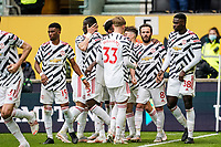 23rd May 2021; Molineux Stadium, Wolverhampton, West Midlands, England; English Premier League Football, Wolverhampton Wanderers versus Manchester United; Manchester United players celebrate after Juan Mata scores a penalty in the fourth minute of injury time of the first half for a 2-1 lead
