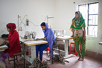 Nasima  Akhter (right), 19, survived the collapse of Rana Plaza on April 24, 2013. Nasima  and another four survivors now work in a model garment factory called 'Oporajeo', a worker-owned factory in Savar, near Dhaka, Bangladesh