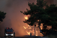 Pictured: Trees are alight near the village of Kalamos.<br /> Re: A forest fire has been raging in the area of Kalamos, 20 miles east of Athens in Greece. There have been power cuts, country houses burned and children camps evacuated from the area.