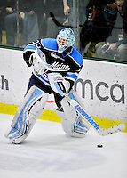 2 December 2011: University of Maine Black Bear goaltender Dan Sullivan, a Sophomore from York, PA, handles the puck in the third period against the University of Vermont Catamounts at Gutterson Fieldhouse in Burlington, Vermont. The Catamounts fell to the Black Bears 6-4 in the first game of their 2-game Hockey East weekend series. Mandatory Credit: Ed Wolfstein Photo